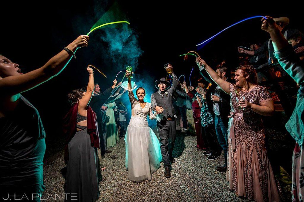 bride and groom fog machine send off at Montana destination wedding
